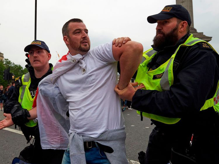 A demonstrator is arrested by police at Trafalgar square after a gathering by supporters of far-right spokesman Tommy Robinson turns violent, in central London on June 9, 2018. (Photo by Niklas HALLEN / AFP) (Photo credit should read NIKLAS HALLEN/AFP/Getty Images)