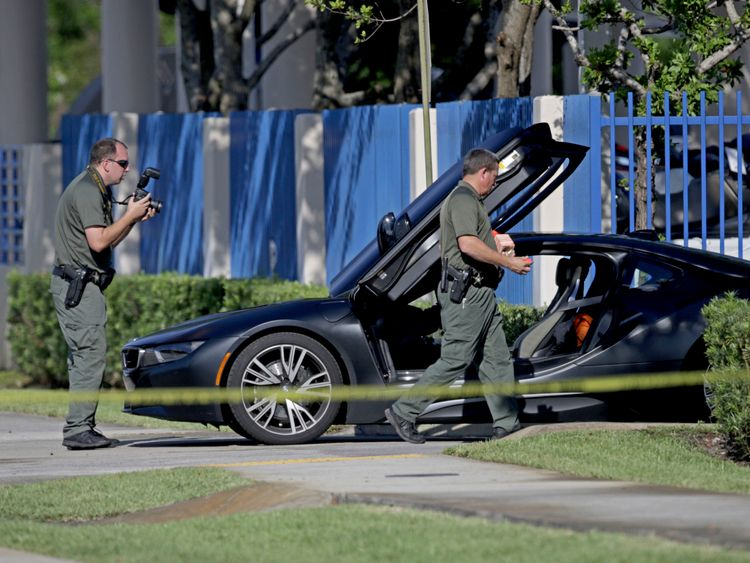 Investigators surround the car in which XXXTentacion was shot
