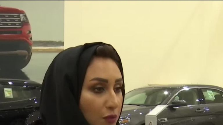 A woman prepares to buy a car in Saudi Arabia