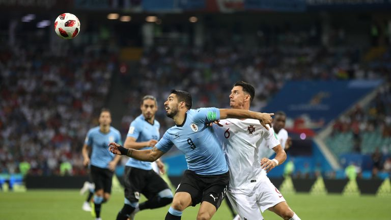 Luis Suarez battles for possession