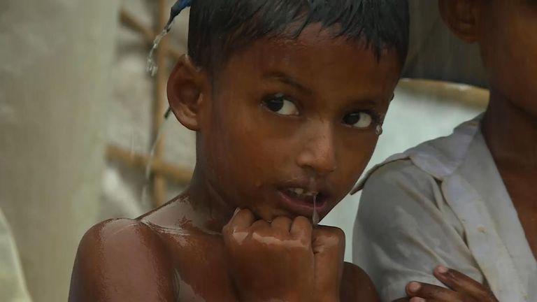 A Rohingya boy in the monsoon rains in Bangladesh