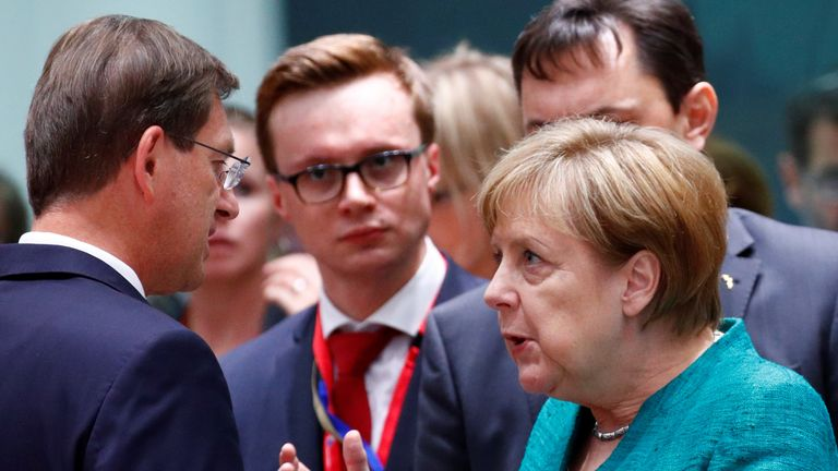 German Chancellor Angela Merkel talks with Slovenian Prime Minister Miro Cerar at EU summit