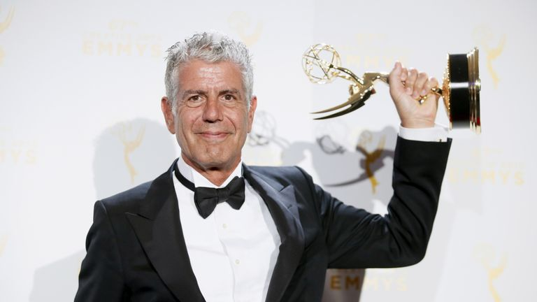 Bourdain with an Emmy Award for Parts Unknown in 2015