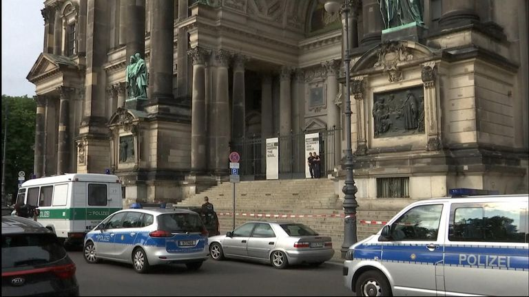 Police vehicles outside the scene of shooting at Berlin Cathedral.