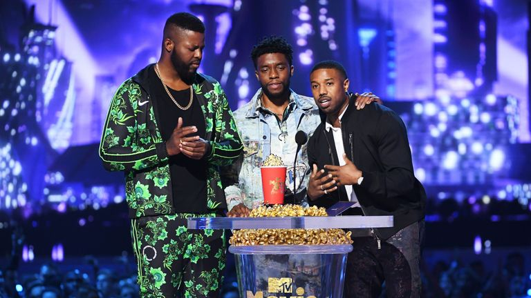Actors Winston Duke, Chadwick Boseman, and Michael B. Jordan accept the Best Movie award for Black Panther