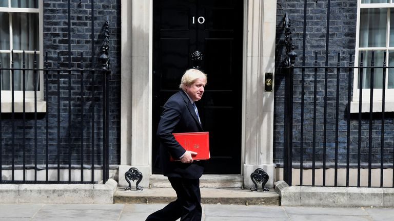 Foreign Secretary Boris Johnson walks past number 10, on his way to the Department for Exiting the EU at No 9 in Downing Street