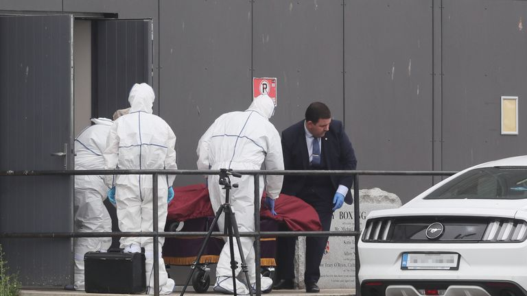 A body is removed from Bray Boxing Club, Bray, Co Wicklow, where three people were shot