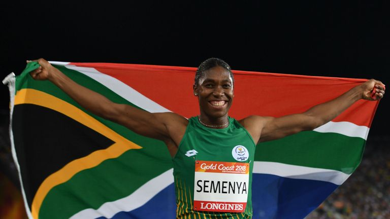 South Africa's Caster Semenya celebrates with flag after winning the athletics women's 800m final during the 2018 Gold Coast Commonwealth Games at the Carrara Stadium on the Gold Coast on April 13, 2018