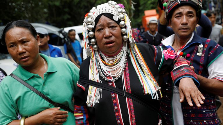 An ethnic Akha woman prays for the return of the missing