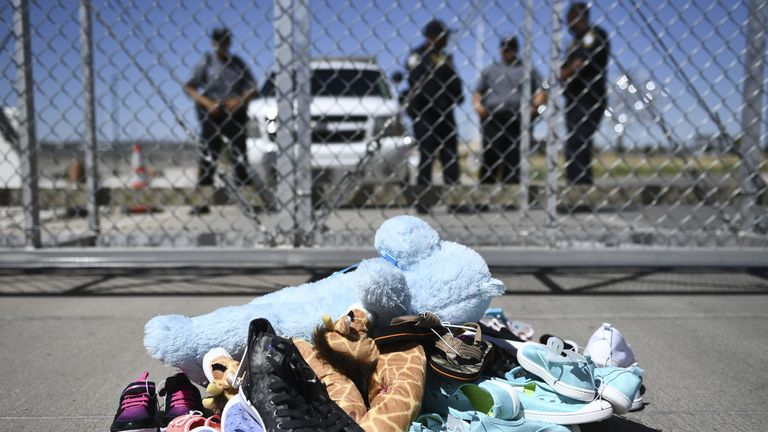 Shoes are left by people at the Tornillo Port of Entry near El Paso, Texas, June 21, 2018 during a protest rally by several American mayors against the US administration's family separation policy