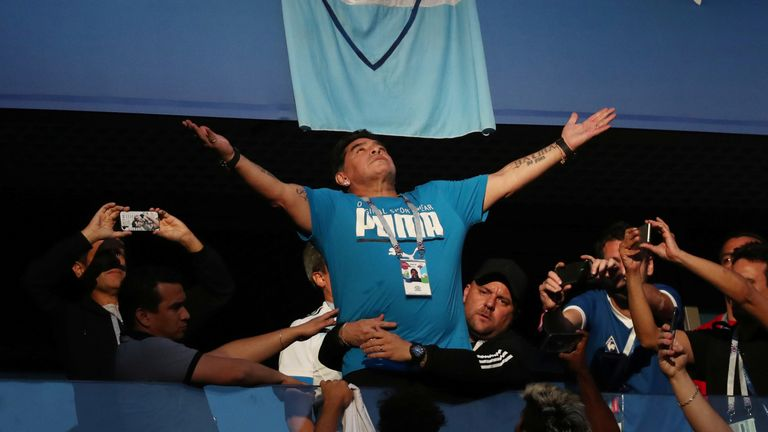 Fans take photos of Diego Maradona in the stands before the match REUTERS/Sergio Perez