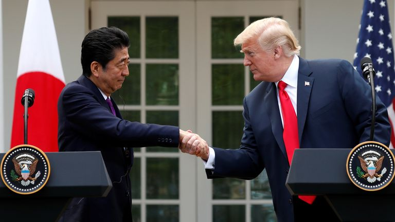 U.S. President Donald Trump greets Japan's Prime Minister Shinzo Abe prior to a joint news conference in the Rose Garden of the White House in Washington, U.S., June 7, 2018. REUTERS/Kevin Lamarque?