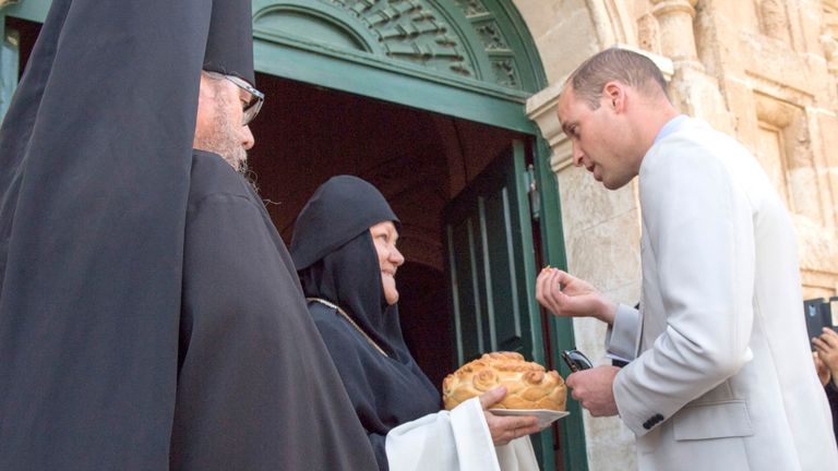 The duke takes bread and salt at the entrance to the church