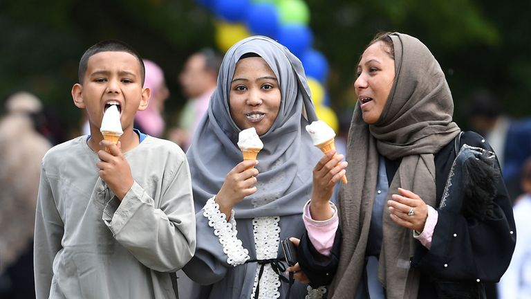Children from the Abdul-Latif family enjoy ice creams after a month of daylight fasting