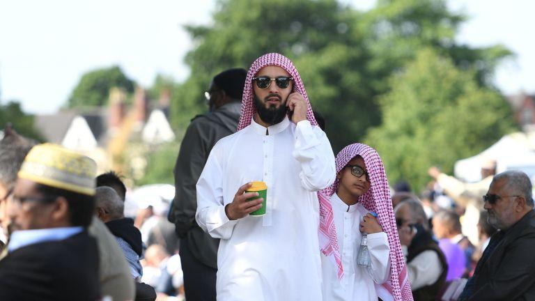 A man and boy attend Birmingham's Eid celebration of the end of Ramadan