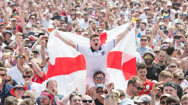 England supporters and festival goers watch England v Panama during the Isle of Wight festival at Seaclose Park, Newport.