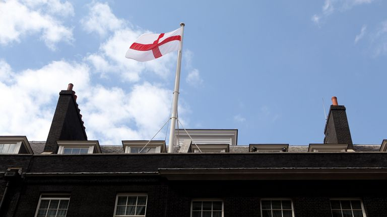 LONDON, ENGLAND - JUNE 12:  A St George's Cross flag flies over Number 10 Downing Street hours before England begin their first game of the FIFA World Cup in South Africa on June 12, 2010 in London, England. British Prime Minister David Cameron has ordered the flag of St George to replace the Union Flag for the duration of the tournament. (Photo by Oli Scarff/Getty Images)
