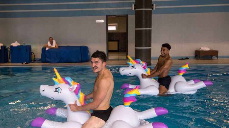 Jesse Lingard and Harry Maguire play with inflatable unicorns