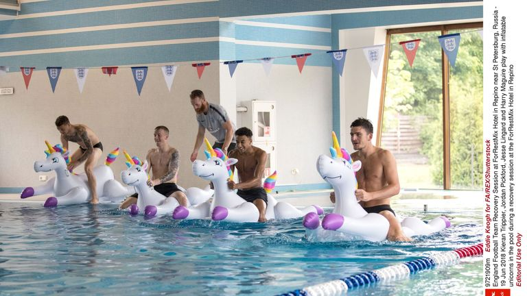 Kieran Trippier, Jordan Pickford, Jesse Lingard and Harry Maguire play with inflatable unicorns