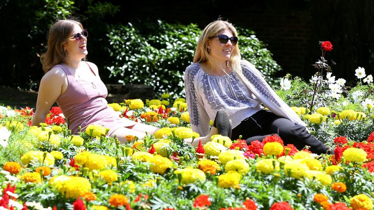 Students enjoy sunshine in Westgate Gardens in Canterbury, Kent, ahead of this weekend's predicted warm weather, when the UK will enjoy temperatures as hot as Spain with the mercury set to soar to a sizzling 30C.