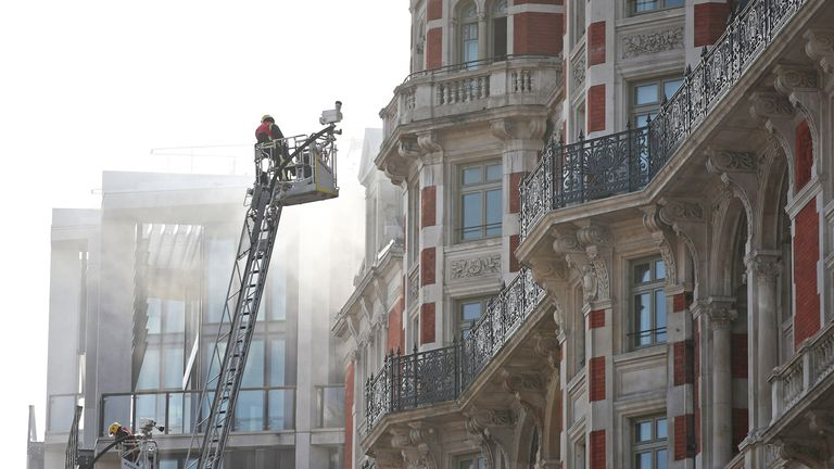 Firefighters at the Mandarin Oriental hotel in Knightsbridge, central London, as London Fire Brigade said fifteen fire engines and 97 firefighters and officers have been called to a fire at the hotel. PRESS ASSOCIATION Photo. Picture date: Wednesday June 6, 2018. See PA story FIRE Knightsbridge. Photo credit should read: Yui Mok/PA Wire