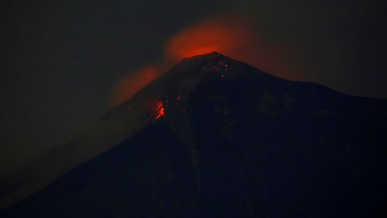 Fuego volcano glows red after erupting violently