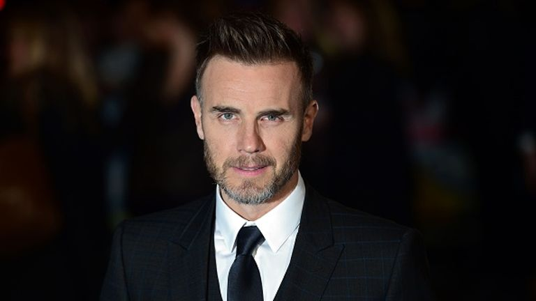Gary Barlow has apologised to environmental campaigners for firing plastic confetti over the crowd