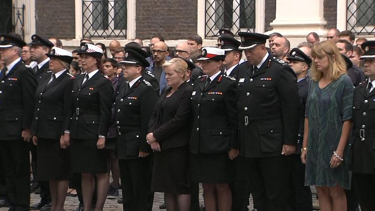 Police officers mark the minute's silence