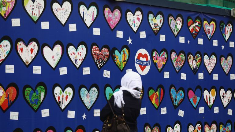 People arrive to attend the commemorations, marking the one-year anniversary of the Grenfell Tower fire