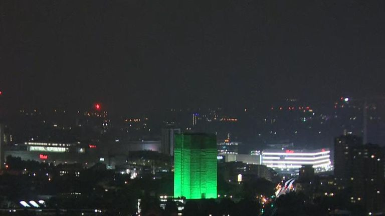 Grenfell Tower lit up green on the first anniversary of the fire