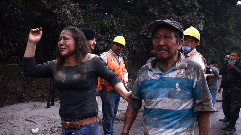 People flee the village of El Rodeo