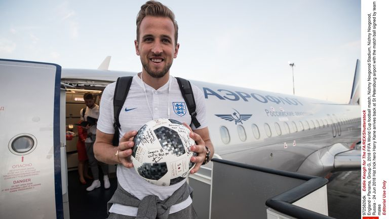 Hat trick hero Harry Kane arrives back at St Petersburg airport with the match ball signed by team mates