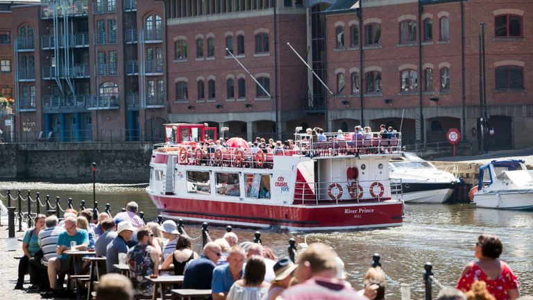 People enjoy the hot weather on the River Ouse in York