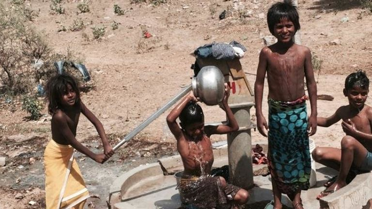 Children collecting and using water at a well in Rajasthan, India. Pic: Avner Vengosh, Duke Univ.