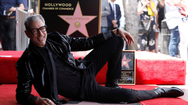 Jeff Goldblum strikes a pose as he unveils his star