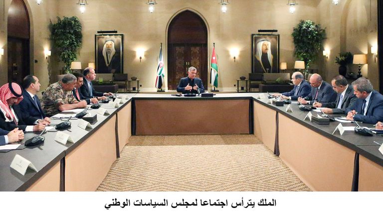 King Abdullah presides over a meeting of top government officials amid a crisis over tax laws