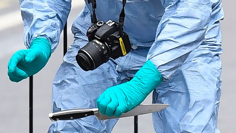 A British police forensics officer holds a knife as evidence is collected on Whitehall near the Houses of Parliament in central London on April 27, 2017, at the scene where a man was detained and taken away by police. Metropolitan police attended an incident on Whitehall in central London near the Houses of Parliament where one man was arrested, police said. Khalid Mohammed Omar Ali, a 27-year-old from north London, is accused of preparing terrorist acts after being arrested not far from PM