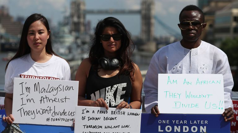Members of various faiths have gathered on London Bridge to mark the anniversary