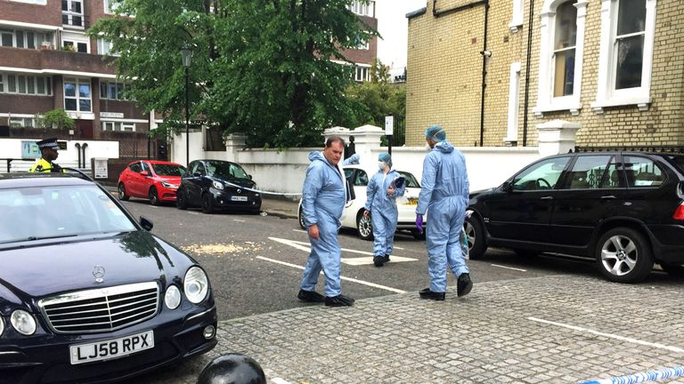 Forensic officers at the scene of Mr Fonatine's death