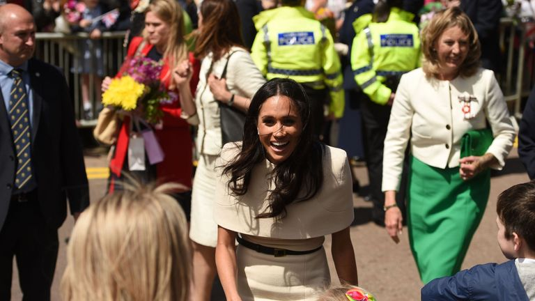 Meghan greets the crowds during a walkabout in Chester