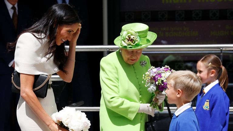 Queen and Meghan take flowers