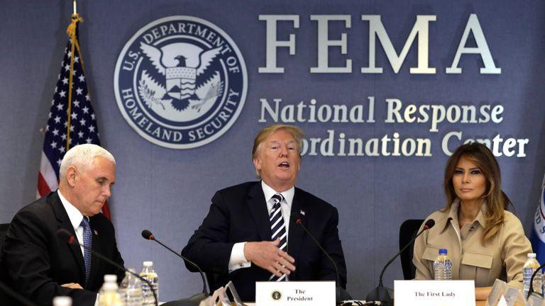 U.S. President Donald Trump with Vice President Mike Pence and First Lady Melania Trump at the Federal Emergency Management Agency Headquarters