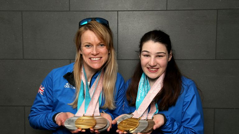 Menna Fitzpatrick (R) and her guide Jen Kehoe pose with their medals after the 2018 Paralympic Winter Games