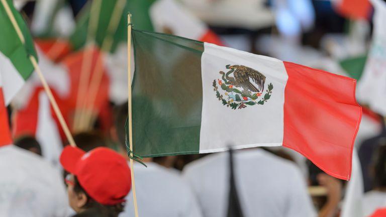 SALTILLO, MEXICO - JUNE 27: A mexican flag waves during the final event of 2018 Election Campaign of Presidential cancidate Jose Antonio Meade at Parque Las Maravillas on June 27, 2018 in Saltillo, Mexico.