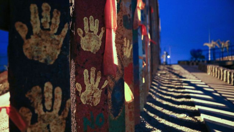 Handprints are displayed on the fence at Friendship Park on the Mexico side of the U.S.-Mexico border fence