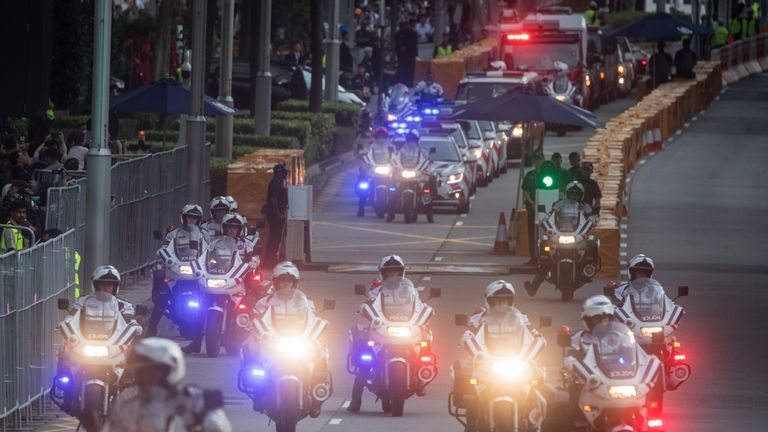 Police clear a major road in Singapore for Kim Jong Un's motorcade