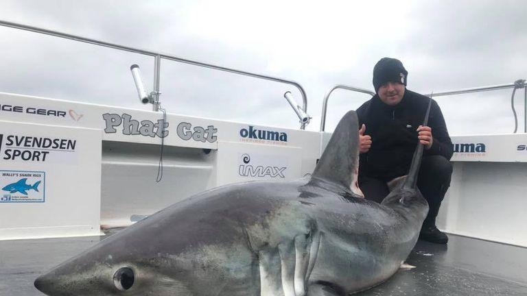 Matthew Burrett with the shark