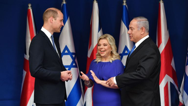 Prince William speaks with Israeli Prime Minister Benjamin Netanyahu and his wife Sara