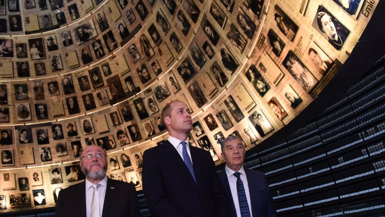 William, Chairman of Yad Vashem Avner Shalev and Britain's Chief Rabbi Ephraim Mirvis visit the Hall of Names