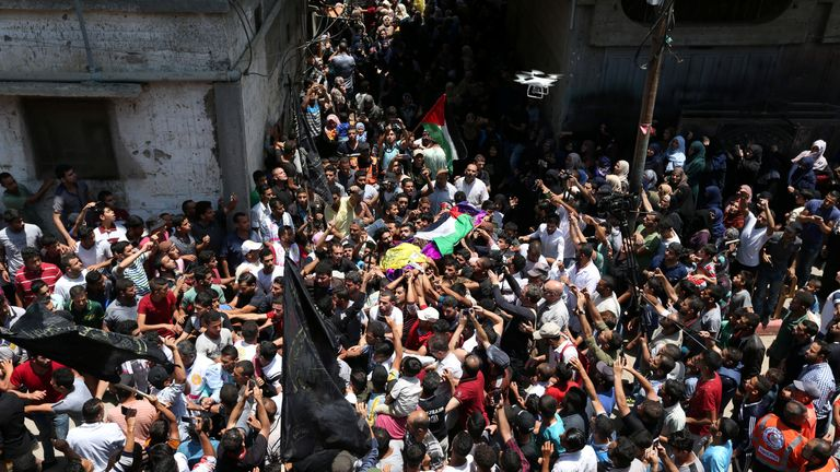 Mourners carry the body of Palestinian nurse Razan Al-Najar